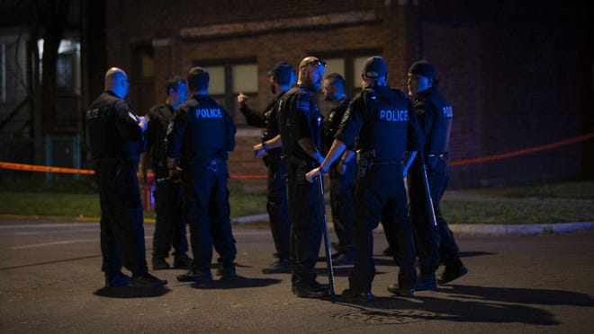 Police at the scene where four people were shot on the 8400 block of Colfax in the South Chicago neighborhood on June 2, 2020.