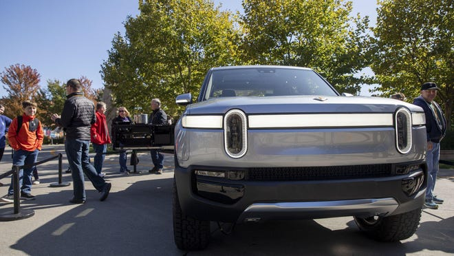 The R1T Truck is on display as people gather during an open house and hiring event hosted by Rivian in Normal, Ill., on Oct. 13, 2019.