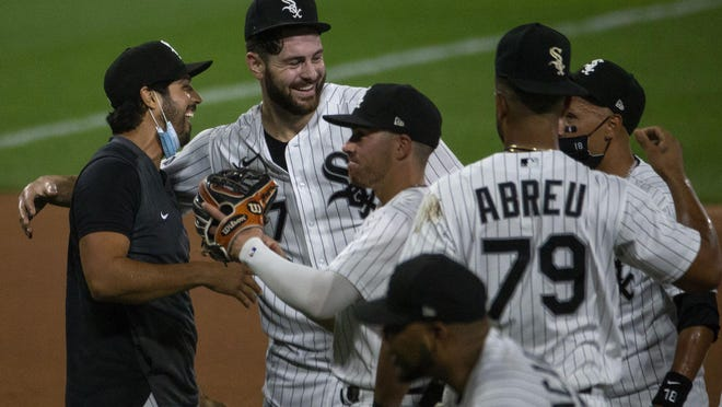 White Sox starting pitcher Lucas Giolito celebrates his no-hitter with his teammates.