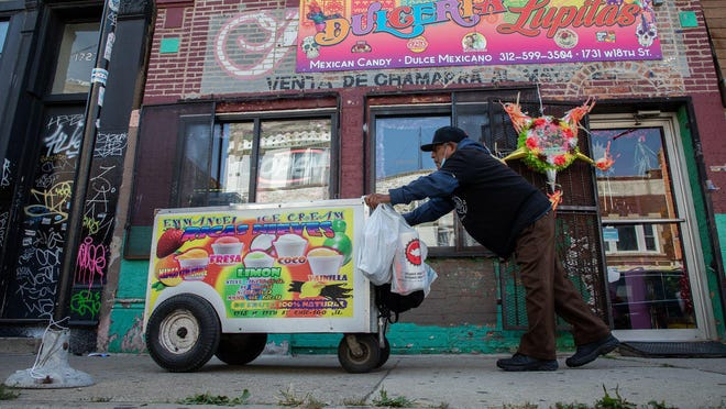 Ananias Ocampo, 76, pushes his cart along 18th Street to Paulina Street to sell ice cream in Chicago's Pilsen neighborhood on Sept. 25, 2020. Ocampo has arthritis, diabetes and osteoarthritis.