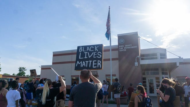 Black Lives Matter protesters gather at the Knox County Law Enforcement Center in downtown Galesburg on Tuesday evening.