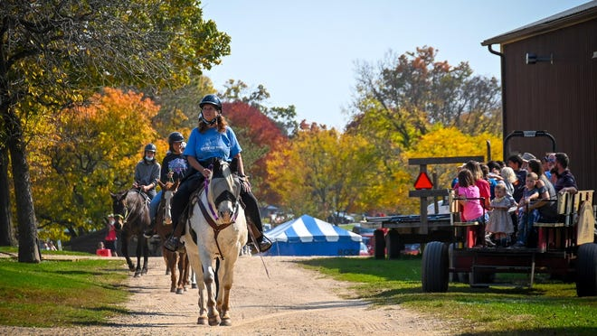 Cindy Long, lead trail guide, leads a group on a horseback ride through Lockwood Park trails in Rockford on Saturday, Oct. 10, 2020, during Fall on the Farm.