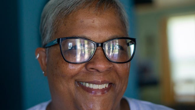 Kim Thierry smiles for a portrait at her house in Galesburg.