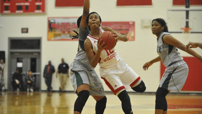 Laney's Jaiden Hamilton eyes the basket between a couple Josey defenders during Friday night's game. DAVID LEE/STAFF