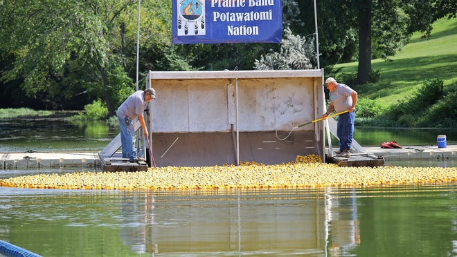 Rubber ducks are dumped from a barge into  Lake Shawnee during the Sertoma Great Topeka Duck Race.