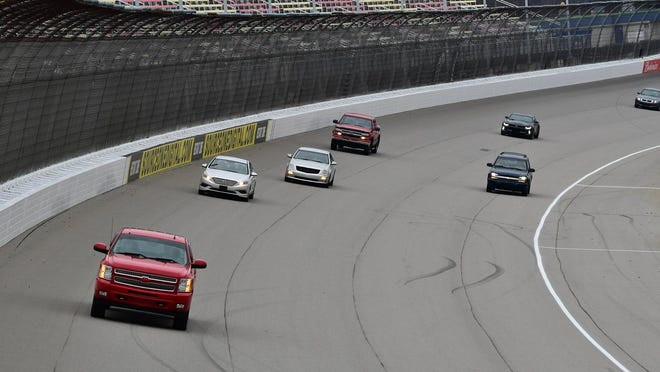 Passenger vehicles take laps around the oval track at Michigan International Speedway during the 2019 MIS Cares Charity Track and Toy Drive. The holiday program allows people the opportunity to take five laps around the two-mile track when they donate nonpersihable food items or a new, unwrapped toy between 9 a.m. and 1 p.m. Saturday, Dec. 5.