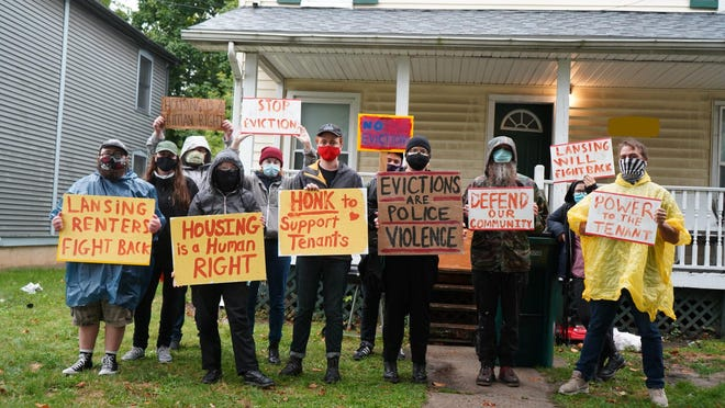 Volunteers from the Lansing Tenant Union protest recently in front of a Lansing house where a tenant is at risk of eviction. Some tenants do not qualify for protection under an eviction ban issued by the Centers for Disease Control and Prevention.