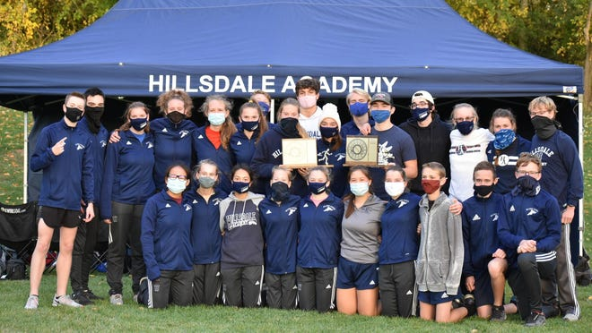 Hillsdale Academy's boys' and girls' cross country teams pose after winning the SCAA Team Championship Wednesday night at Hillsdale College's Hayden Park. The Colts' teams won all three SCAA Jamborees this season. COURTESY: Hillsdale Academy