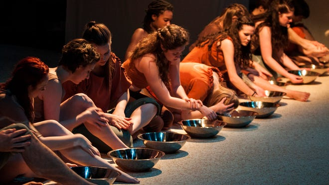 """Luther College students performed in """"Body of Water,"""" a multimedia performance about water quality, last weekend in Decorah."""