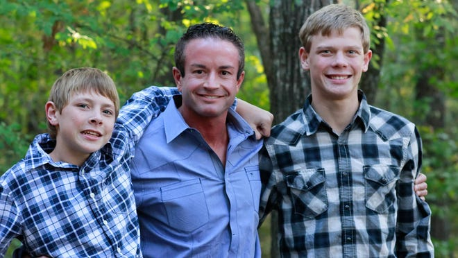Ruslan, Timothy and Elijah Stubbs pose for a photo in 2012, the year they were adopted from the Ukraine.