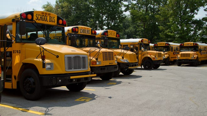 Jefferson Co. Public School buses sit in the Jeffersontown Bus Compound. August 1, 2014. While the compound will remain open, JCPS eliminated two elementary bus depots at the site this school year, along with four others district wide, a move that should reduce travel times for some elementary students.