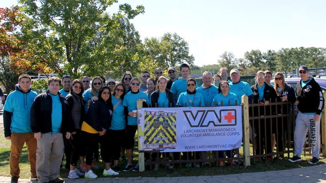 """Three dozen members from """"Team Larchmont VAC"""" raised more than $6,000 for the American Foundation for Suicide Prevention as part of the foundation's """"Out of the Darkness"""" Suicide Prevention Walk on Oct. 5. The team from the Larchmont/Mamaroneck Volunteer Ambulance Corps walked 3 miles around Mamaroneck's Harbor Island Park to raise awareness and funds in support of the AFSP mission."""