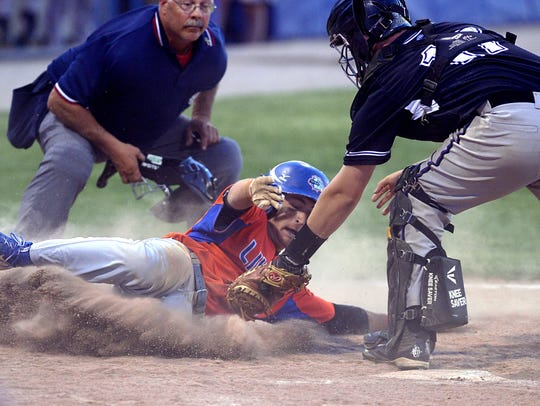 Greece Odyssey catcher Pat Bigham, right, tags Livonia's