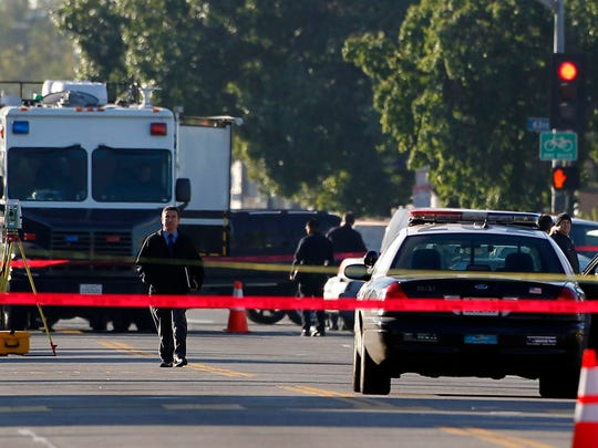 Los Angeles police officers investigate a shooting