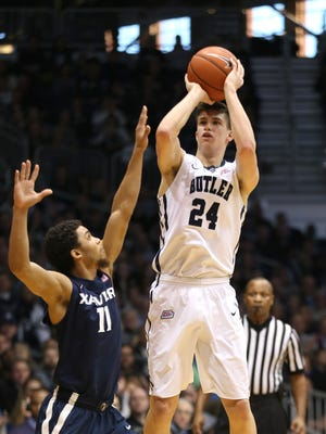 Butler's Kellen Dunham shoots a three pointer over Xavier's Dee Davis at Hinkle Fieldhouse, Jan. 10, 2015.