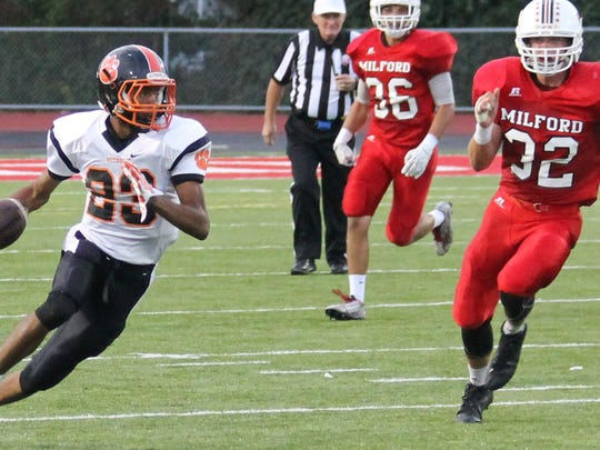 Withrow wide receiver Aaron Shannon turns upfield and scores the Tigers' first touchdown of the game.