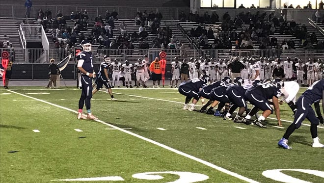 Tyler Collier lines up the Chambersburg offense.