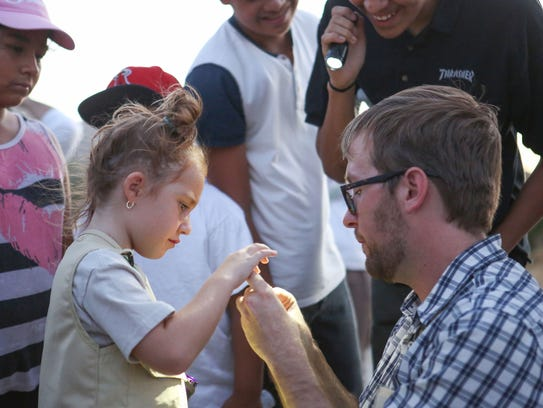 Desert wildlife expert Colin Barrows shows six-year-old