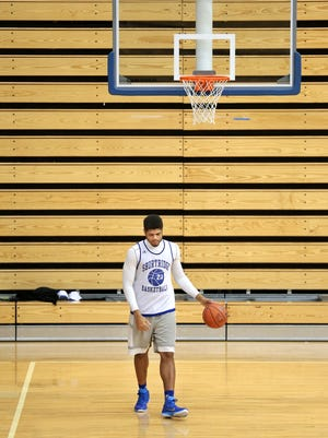 Shortridge senior Various Wilson warms up by himself before the start of practice Dec. 18, 2014.