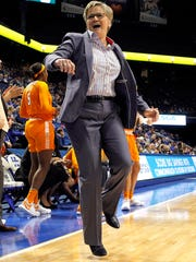 Tennessee head coach Holly Warlick leaps as Tennessee