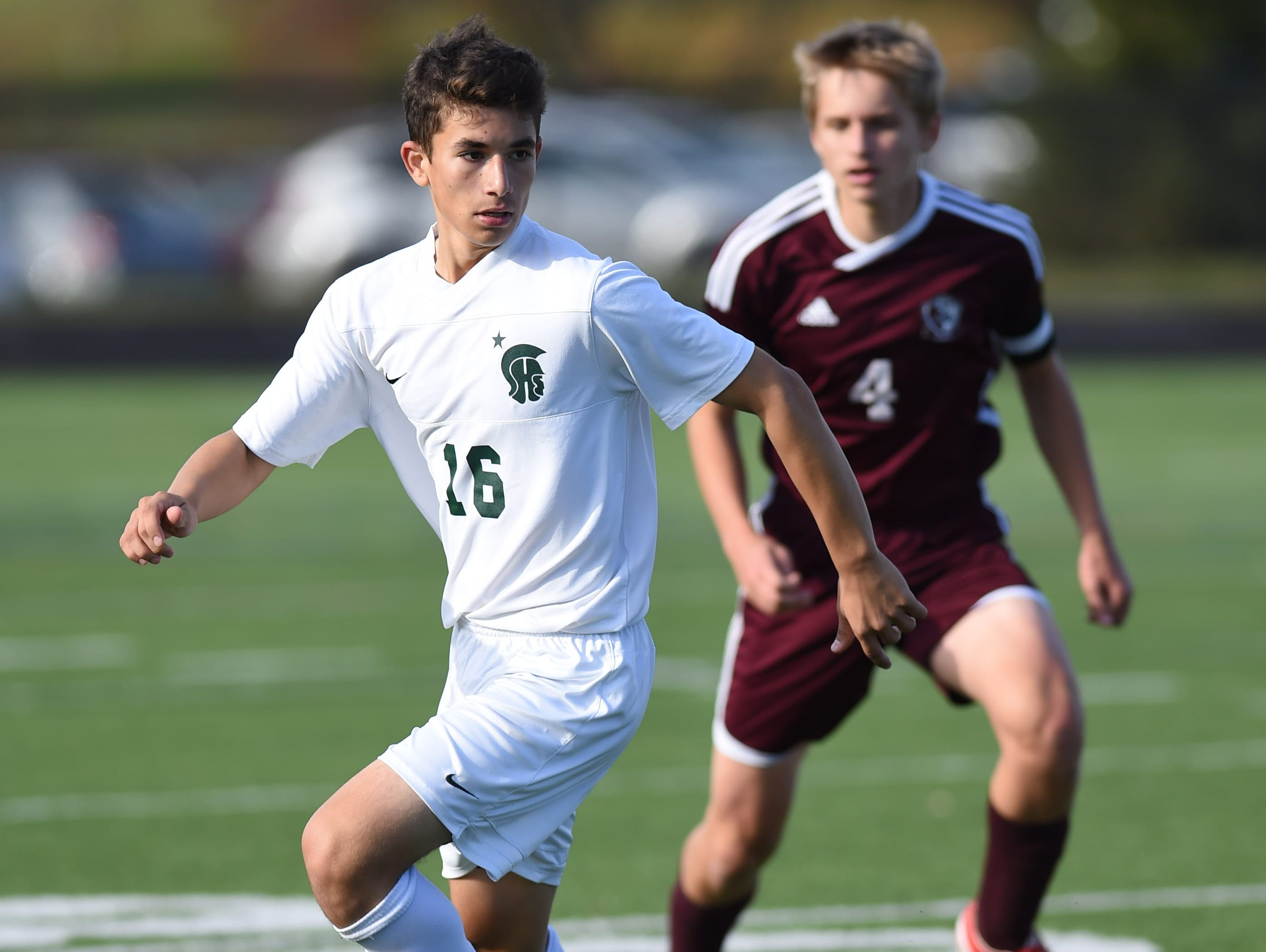 Spackenkill's Andrew Moreira looks for a teammate to pass the ball to as O'Neill's Aleks Rosenbaum covers him during the Section 9 Class B final held in Marlboro on Saturday.
