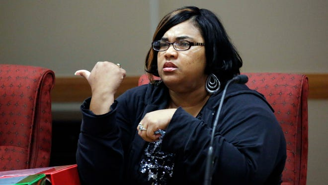 Frances Smith-Kemp , a Clarksdale, Miss., elementary school teacher, responds to a question during a Tuesday, June 16, 2015, hearing in Jackson before the Commission on Teacher Licensure over the revoking of her teacher's license.