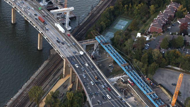 """These giant blue girders for the new Tappan Zee Bridge will be """"rolled"""" over Metro-North's Hudson Line tracks in Tarrytown starting this weekend."""