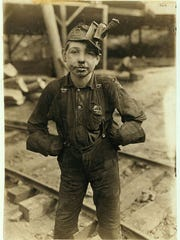 A Tipple Boy outside the , Turkey Knob Mine,, Macdonald, W. Va. circa 1908 - and maybe a coworker of Marco and Gaetano. The miners day started at 7:00 a.m., ended at 5:30 p.m. Witness E. N. Clopper.