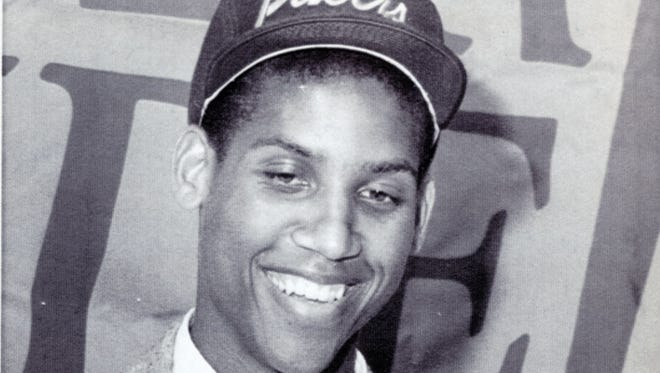 Reggie Miller smiles after receiving a basketball as a momento from the Indiana Pacers as their first round draft pick in this June 24 1987 AP file photo
