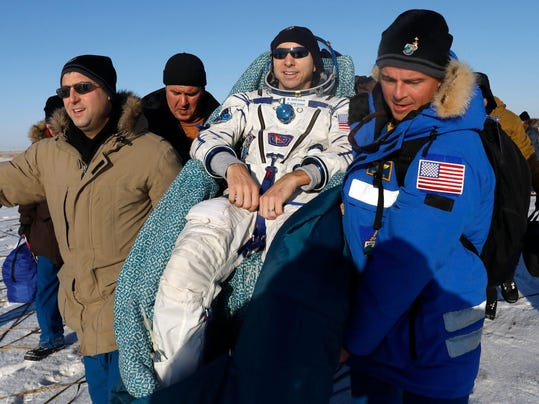 KAZAKHSTAN-RUSSIA-US-ITALY-ISS-SPACE-LANDING