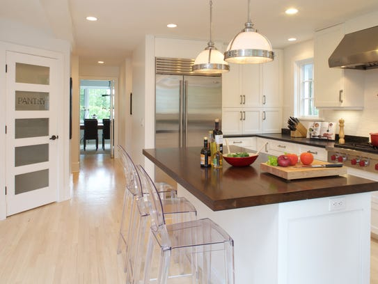 Kitchen by JWH Design & Cabinetry
