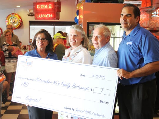 Nancy Butcher, pictured second from left, won a national recipe contest sponsored by General Mills. She and her husband, Steve, pictured third from left, own Nutcracker Family Restaurant. They are pictured here with David Demeo and Tami Bay, both of General Mills. The pair presented the Butchers with a blank check on June 15. They were scheduled to learn how much they won via the contest earlier this week.