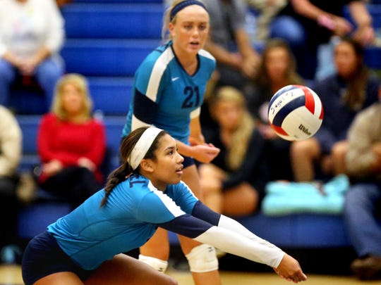 Siegel's Asha Phillips (7) bumps the ball as teammate Leah Poarch (21) watches in the background during the TSSAA Class AAA Sectional against Walker Valley, on Thursday, Oct. 15, 2015, at Siegel.