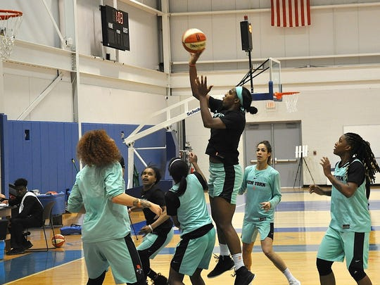 NY Liberty's Reshanda Gray goes up for a jumper during May 16 practice.