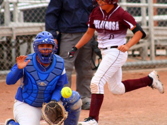 Tularosa eighth-grader Romona Fossum beats the throw to home-plate Tuesday afternoon.