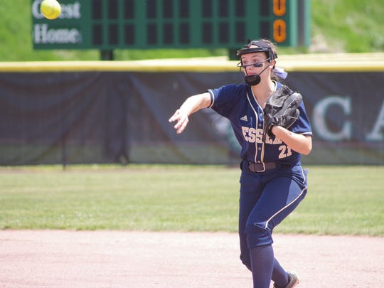 Essex's Regan Day throws to first base during the first inning during Saturday's championship.