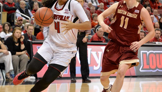 Louisville's Mariya Moore, left, drives around Boston College's Nicole Boudreau during the second half of an NCAA college basketball game Thursday, Feb. 26, 2015, in Louisville, Ky. Louisville won 77-60. (AP Photo/Timothy D. Easley)