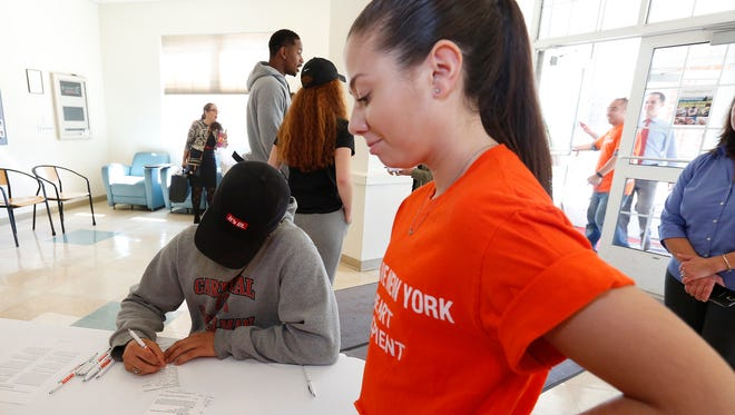 Lauren Shields, 16, an heart transplant recipient assists Raymond Arno, 22, from Harlem, complete his registration form during an organ donor registration drive at Dominican College in Orangeburg on Thursday, October 6, 2016.  October 6th is National Organ Donor Day.