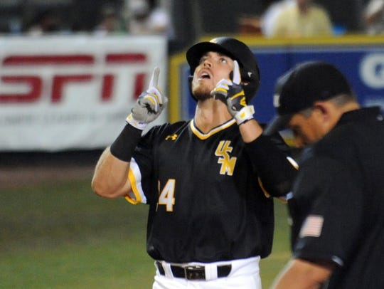 Southern Miss' Dylan Burdeaux points toward the sky