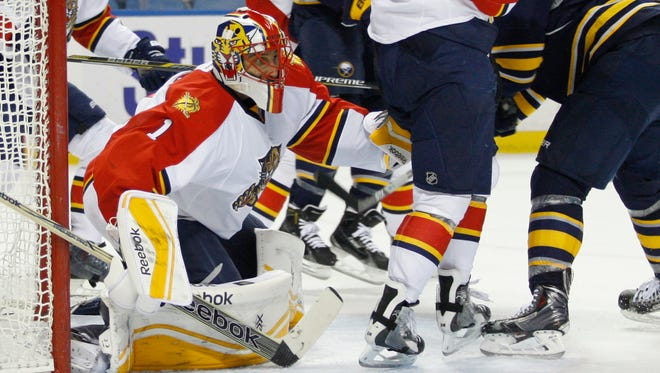 Florida Panthers goalie Roberto Luongo (1) looks for the puck during the second period against the Buffalo Sabres at First Niagara Center.