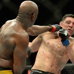 Anderson Silva (red gloves) and Nick Diaz (blue gloves) fight during their middleweight bout during UFC 183 at the MGM Grand Garden Arena.