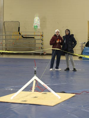 Fatima Catovic (left) and Inayah Ahmad of Noor-Ul-Iman School in the Monmouth Junction section of South Brunswick, fire their bottle rocket during the 26th Annual State Finals of the New Jersey Science Olympiad on March 15 at Middlesex County College in Edison.