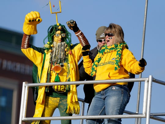 Fans party before the Packers-Lions game at Lambeau