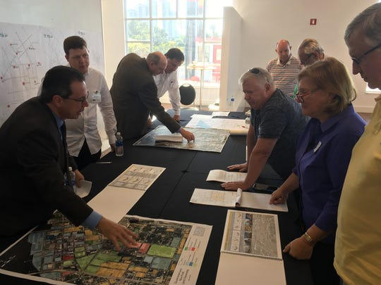 Steve Belden, near left, explains a piece of the proposal to the public during a workshop Thursday at the City Pier in downtown Fort Myers.