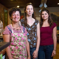 From left, Carol Ostrander, owner of Carol's Coffee and Art Bar, with baristas Lindsay Barnes and Madison Johnston inside the Owego coffee shop.