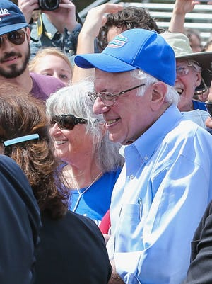 Democratic presidential candidate, Sen. Bernie Sanders, I-Vt., greets supporters at the end of a campaign rally at the University of Florida in Gainesville, Fla., Thursday.