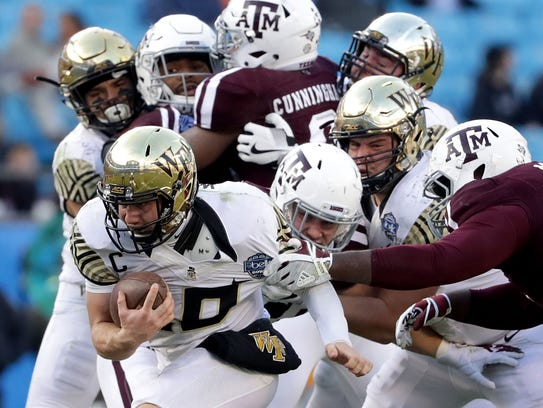 John Wolford of Wake Forest runs with the ball against