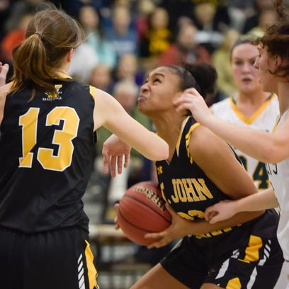 Sajada Bonner (23) of SJV looks to shoot in a crowd.