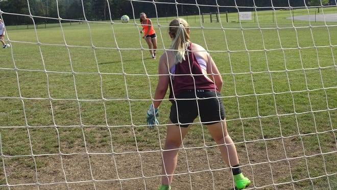 Licking Heights sophomore Kaitlin Brun takes a shot against freshman goalkeeper Alexis Caugherty during a recent practice.