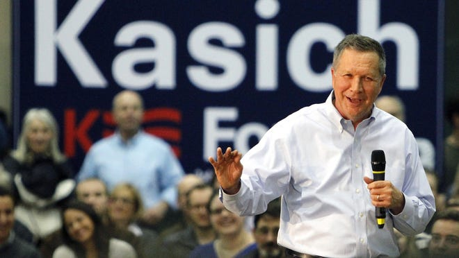 Republican presidential candidate John Kasich speaks during a town hall meeting Friday in Syracuse, N.Y.
